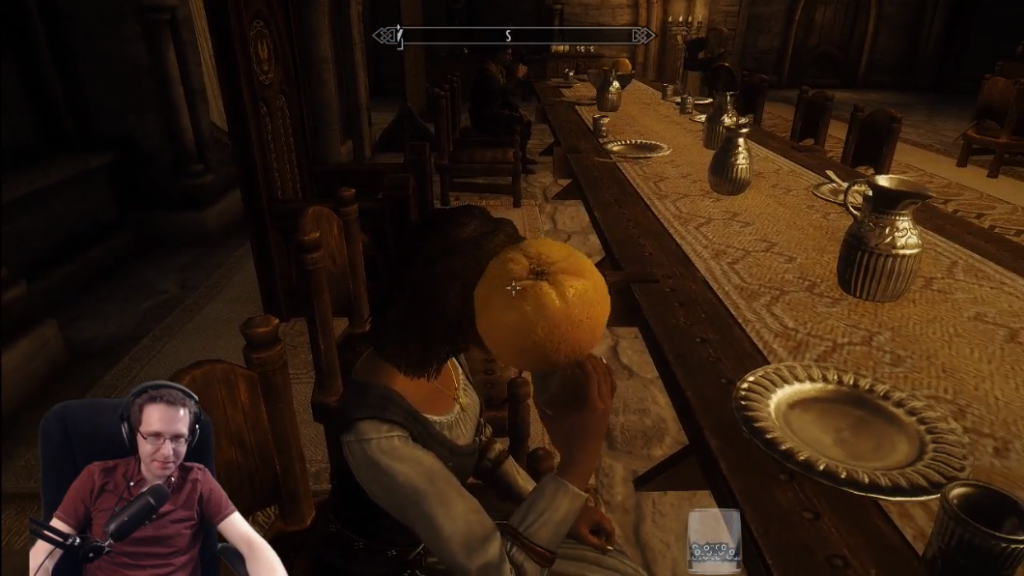 Shows me playing with an orange during my return to Skyrim.